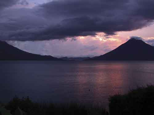 Pink sunset over Lake Atitlán (photo: Harris and Goller/viaventure.com)